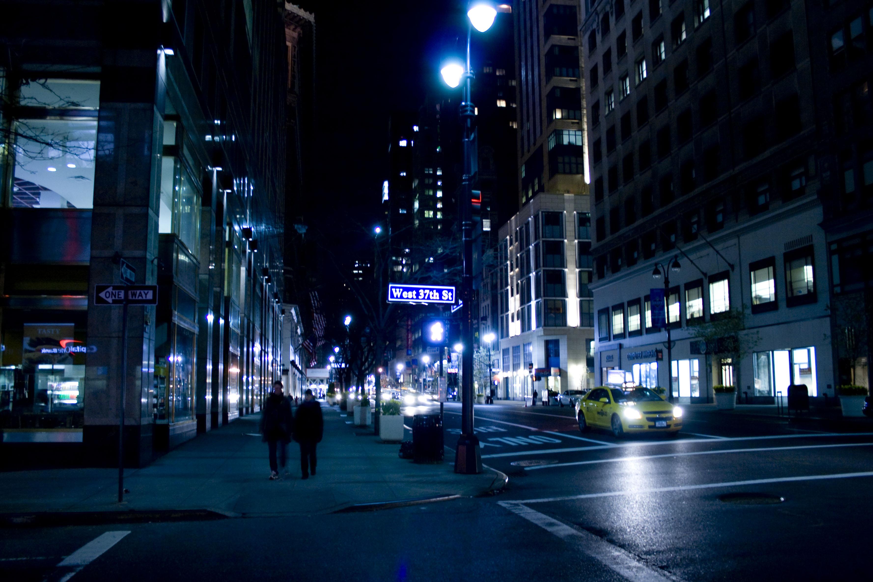 Man walking down the street at night
