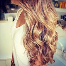 Honey blonde curly hair