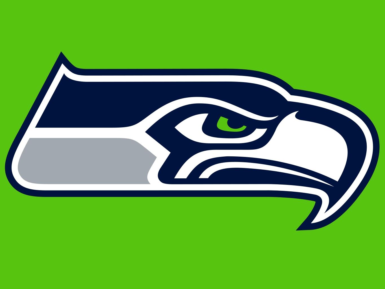 Get The 2014 Superbowl XLVIII Makeup Looks: Seattle Seahawks vs. Denver Broncos - White Lids, Navy Liner Cat-Eye/Smoky Navy Eyes, Orange Lip: Trends
