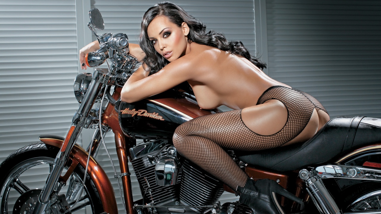 Big tit woman on motorcycle