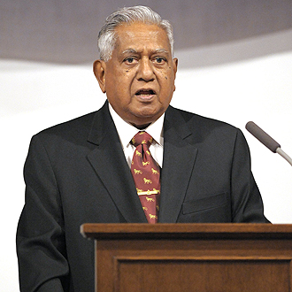 S R Nathan looking at things