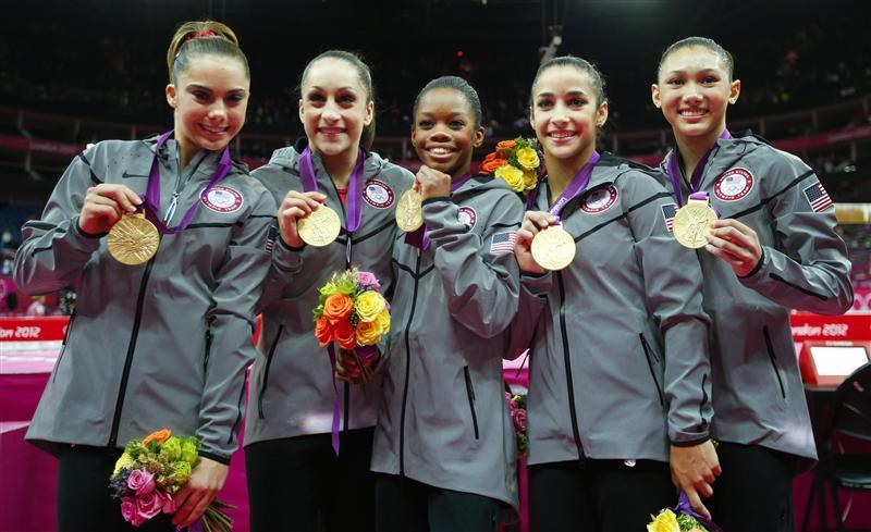 The Fierce Five flash their gold medals.