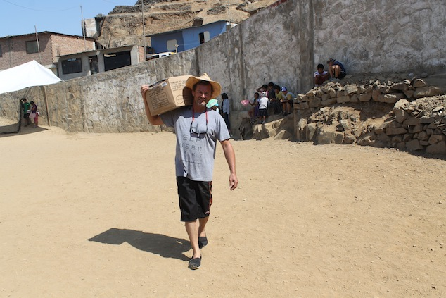 Vern carries box in Peru