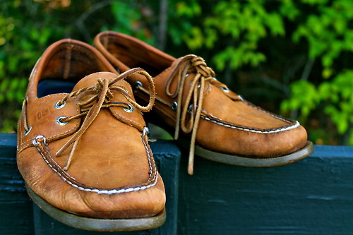 a pair of well worn sperrys