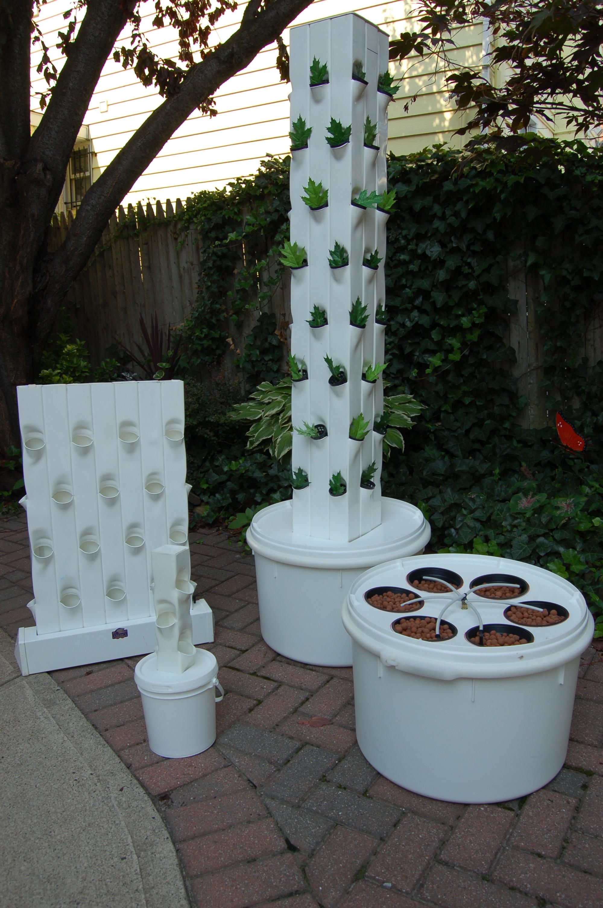 Garden up urban gardening living here s a garden up for Vertical garden tower