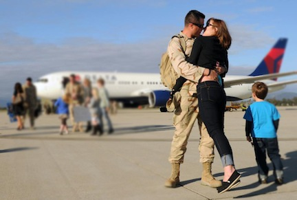 Soldier kissing wife in TOMS